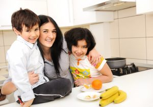 mother and kids with healthy snack
